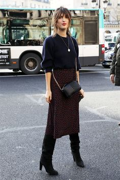 Black top, burgundy midi skirt, and black boots Street style, street fashion, best street style, OOTD, OOTD Inspo, street style stalking, outfit ideas, what to wear now, Fashion Bloggers, Style, Seasonal Style, Outfit Inspiration, Trends, Looks, Outfits.