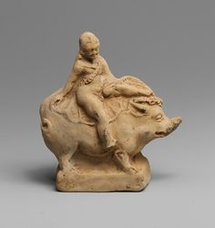 Terracotta statuette of Eros riding a boar 11.1cm high (43/8 inch.) Greek culture, made in south of Italy, Hellenistic Period, 3rd century BC. Source: Metropolitan Museum