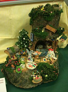 dollhouse miniature easter/spring | Miniature Easter Bunny scene in a hollow stump exhibited by Monine ...