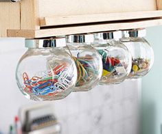 Nail the lids of shapely jars under a cabinet for pretty — and easily accessible — storage. Click for more storage ideas.