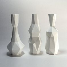 Enjoy a 3d printed vase set of 3. These bold geometric vases were inspired by the painting technique called cubism, made famous by Picasso. This plastic vase set comes in multiple sizes and colors to suit your decorating needs. You can place real or silk flowers in them, or display the