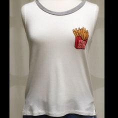 Fries Before Guys Tee White Fries Before Guys Tee. Sleeveless. 95% rayon 5% spandex. Block style. Lower in back and shorter in the front.  trades April Spirit Tops Tank Tops