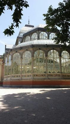 """The Palacio de Cristal (""""Crystal Palace"""") is a glass and metal structure located in Madrid's Buen Retiro Park. It was built in 1887 to exhibit flora and fauna from the Philippines, then a Spanish colonial possession. The architect was Ricardo Velázquez Bosco. The cast-iron frame was manufactured in Bilbao. The structure was designed in a way that would allow it to be re-erected on another site. However, the building always remained on the original site, next to a lake... Colonial Architecture, Architecture Design, Glass Conservatory, Spanish Colonial, Madrid, Crystal Palace, Bilbao, Philippines, Taj Mahal"""