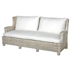 Woven rattan and teak wood sofa. Product: SofaConstruction Material: Rattan and teak woodColor: Beige and whiteFeatures: Cushions includedIntricately woven rattanBeautifully stained legsDimensions: 35 H x 79 W x 34 D