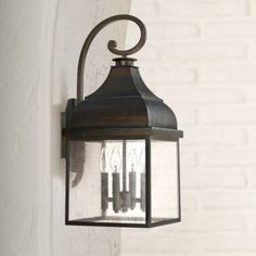 """CAP WESTRIDGE This large, square lantern style bronze outdoor wall light is a perfect choice for a stylish home like yours. 24 1/2"""" high x 11"""" wide. Extends 12 3/4"""" from the wall. Back plate is 8"""" high x 5"""" wide x 3/4"""" deep. Back plate center of junction box to top of fixture is 14"""". Style # 1H821 at Lamps Plus."""