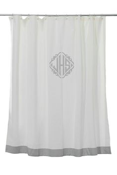 Love a classic monogram on a shower curtain via Leontine Linens