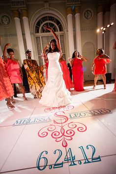 Bride dancing at Biltmore Ballrooms wedding reception. Custom dance floor decal by I Do Linens.