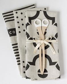 The Noir Tea Towel Set, with wooden Toast Tongs.
