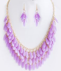 This gorgeous jewelry set consists of a necklace and matching earrings designed with vibrant, teardrop-shaped, acrylic stones, multi-layered in a...
