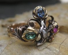 Georgian Giardinetti Ring. Giardinetti - means garden - a design motif popular in the 18th & 19th centuries. 3 flowers are accented by a Brilliant Blue Sapphire, Fuchsia Ruby & Vibrant Green Emerald & a leaf accented by a Rose Cut Diamond.  Circa 1700