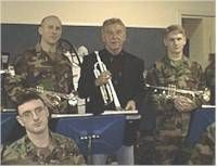 Doc Severinsen served 2 years in the Army during WW2. He is seen visiting with some Army band members.