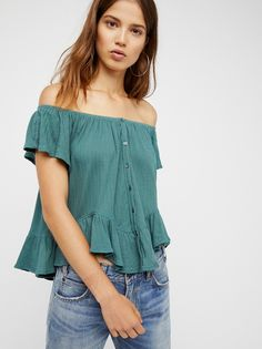 Mint Julep Tee | Sweet off-the-shoulder top featuring flowy sleeves and a ruffled hem. Front button closures. Elastic at the neckline for an easy fit.