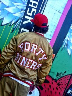 """THIS SAN FRANCISCO FORTY NINERS SATIN JACKET IS IN ITS CLASSIC ALL TEAM GOLD COLOR WITH   RED & WHITE LINING! HELMET LOGO ON THE CHEST &  """"FORTY NINERS"""" ON THE BACK! SIZE XL! BY CHALKLINE. magikmania.com"""