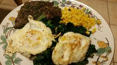 Low carb/no carb meal. Eggs over kale, steak and corn. Yum