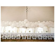 Up, Up, And Away: An outdoor wedding in a tent can be fun for so many reasons. For an intimate vibe, hang white lanterns from above.