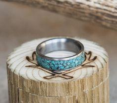 Men's turquoise wedding ring.