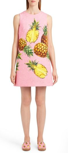 Sunny yellow pineapples float atop this flamingo-pink jacquard shift dress sewn with angular darts at the side to sculpt a sharp A-line silhouette.