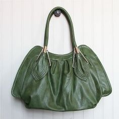 still dying for a new bag.  this one looks like it might fit the bill.
