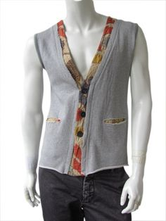 Designer: Nicolas & Mark    Item: Waistcoat    Composition: 100% Cotton    Made in Italy    Description:         Waistcoat in grey fleece with V-neck. Borders in Indian patchwork fabric. Open pockets on the front. Hidden fastener and  raw cut.      > Need Help?    Price $ 247.00 $124.00    Discount: -50%