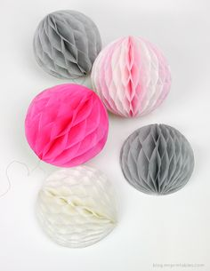 DIY How to make honeycomb pom-poms from tissue paper http://blog.mrprintables.com/how-to-make-honeycomb-pom-poms/