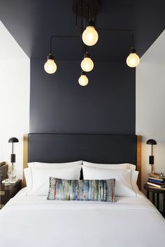 Design Detail - The headboards in this hotel suite are visually extended up the wall and across the ceiling