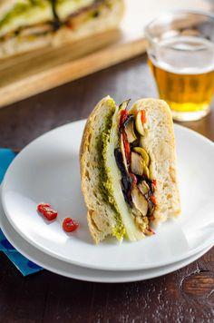 Vegetarian Muffuletta Sandwich for Mardi Gras: Easy recipe for a wonderfully savory vegetarian muffuletta sandwich + vegan adaptation. Celebrate Mardi Gras (or Mardi Gratzer, if you wish) in style. Vegetarian Recipes Dinner, Vegan Recipes, Dinner Recipes, Cooking Recipes, Vegetarian Sandwiches, Vegetarian Food, Going Vegetarian, Meatless Recipes, Vegetarian Breakfast