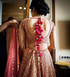 Indian Bride | Wedding Lehenga | Bridal Lehenga inspiration | Pink Lehenga with golden shimmer | wedding Dress | Photography by Stories by Joseph Radhik | Dress Test | deep scope back blouse with pink tassel latkans | Bride getting ready | Every Indian bride's Fav. Wedding E-magazine to read.Here for any marriage advice you need | www.wittyvows.com shares things no one tells brides, covers real weddings, ideas, inspirations, design trends and the right vendors, candid photographers etc.