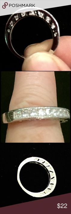 White topaz band Beautiful sterling silver plate band. White topaz along the top as well as both sides of the top, shown. No Hallmark. Lovey! ~~ I do not have an appraisal, therefore the low price- as this was donated for the animals. However, I just left the jewelers with about 12 pieces that will be added today. I wanted to ck my facts on each piece.I didn't pay to have each weighed~~ Jewelry Rings