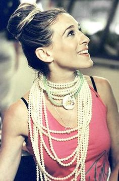 Carrie in pearls and bun