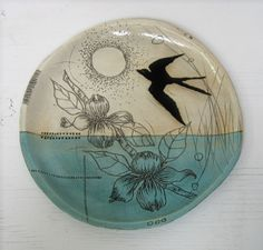Love this pottery (?) plate....colors and artwork.