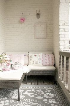 Loggia + patio + white washed brick wall + whites and pinks. And, check out that gorgeous rug!
