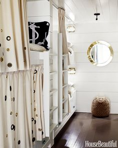 The bunk room feels like a ship's cabin and is lined with six bunks, four on one side and two on the other in a Marin County, California, house.