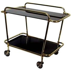 Italian 1950s Brass & Black Glass Bar Cart Tea Trolley Serving Cart | From a unique collection of antique and modern bar carts at http://www.1stdibs.com/furniture/tables/bar-carts/