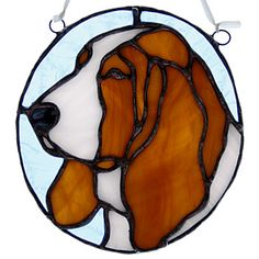 I love this little suncatcher/ stained glass panel.