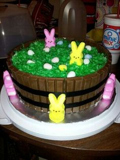 Easter Kit Kat cake...  Bake two round cakes (I used strawberry) and frost as you normally would (I used cream cheese frosting). Break the kit Kat bars in two's and place around the cake. I used black ribbon, but you can use whatever you prefer and I used glue dots to hold the ribbon in place. Then I colored coconut with green food coloring for the grass look, put peeps and Mini Cadbury eggs on for decoration. So easy and fun!!