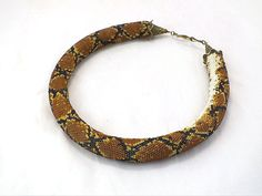 Bead crochet rope necklace with snake skin por RebekeJewelry