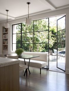 Have you seen the latest interior design trend of gorgeous, black steel windows and doors? I've decided it can work in both modern or traditional settings. Steel Windows, Black Windows, Wall Of Windows, Big Windows, Iron Windows, Floor To Ceiling Windows, Home Windows, Kitchen Windows, Dining Room Windows
