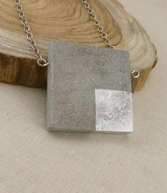 Feel the smooth coolness of concrete against your collarbone, and know you're making a statement. The concrete square is accented by silver leaf in the lower right quadrant. Concrete Square Necklace Handmade Jewelry – Made For Giving Enamel Jewelry, Resin Jewelry, Beaded Jewelry, Handmade Necklaces, Handmade Jewelry, Cement Jewelry, Beton Diy, Mothers Bracelet, Funky Jewelry