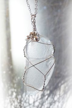 This handmade pendant features an elongated piece of translucent clear sea glass collected from a Long Island beach. It's set in a sterling silver wire wrap accented with tiny sterling silver beads reminiscent of bubbles in the water.  $48