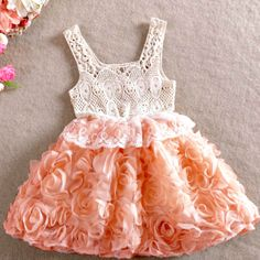 A true vintage inspired classic!  A crochet sleeveless bodice in beige tops a peachy pink rosette skirt (lined in cotton jersey) with a lace trim highlighting the waistband.  Available in sizes 18 months, 2T, 3T, 4T and 5/6.