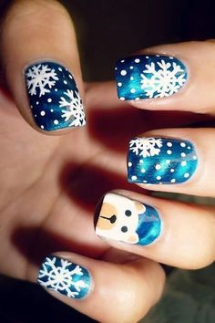 Loving this blue nail color. The snowflake nail art and the polar bear are just too cute! #Christmas #nails #festive #snowflakes #polarbear