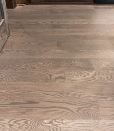 White Oak Flooring with a Custom Stain and Matte Finish. White Oak grain is very consistent which allows even staining of each piece. Natural undertones are grey and golden hues. White Oak is dense and durable in high traffic areas