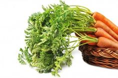 heap of fresh carrots with leaves  in  basket Stock Photo