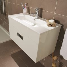 Aspen Compact 700 Wall Mounted 1 Drawer Vanity Unit | The Aspen Compact 700 wall mounted 1 drawer vanity unit. A fantastic and unique range of bathroom furniture the Aspen Compact range is designed with a short projection making it ideal for any modern bathroom including small bathrooms and cloakroom bathrooms. This 700 wall mounted unit has 1 soft close drawer for storage chrome finish handles and a high quality ceramic basin.