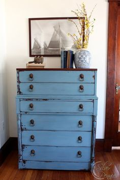 "The ""Grantham Dresser"" in MMS Milk Paint French Enamel.  I love the original lions head pulls!"