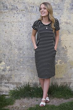 """Black and white striped knee length dress. - Light weight and comfy! - Side pockets - Hits below the knee Model is 5'8"""" wearing a small. Runs true to size. Small (0-4), Medium (4-8), Large (8-12) 96%"""