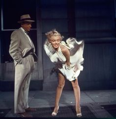 """Marilyn Monroe breezes through filming with her �""""Seven Year Itch"""" co-star Tom Ewell in a photograph by Sam Shaw. �It was Shaw's idea to orchestrate the """"flying skirt"""" image and use it to promote the movie. �(Photo � Sam Shaw Inc. licensed by <a href=""""http://shawfamilyarchives.com/"""">Shaw Family Archives</a>)"""