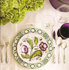 That green/white charger with that gorgeous botanical plate is just stunning...especially with the purple stemware.  Wow.