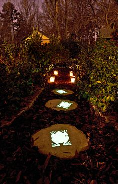 stepping stones painted with glow in the dark paint - i just love anything frog's guess am going to have to do this one - thanks for pinning it