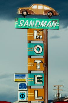 "Aaah.. It's The Sandman Motel with A '57 Chevy ( or so...) on Top! Reminds me of Ordering Ice Cream 0r Saying ""Pretty Please, with Sugar on Top""! Ok - So Who REally Knows The Make and Model of This Car?"